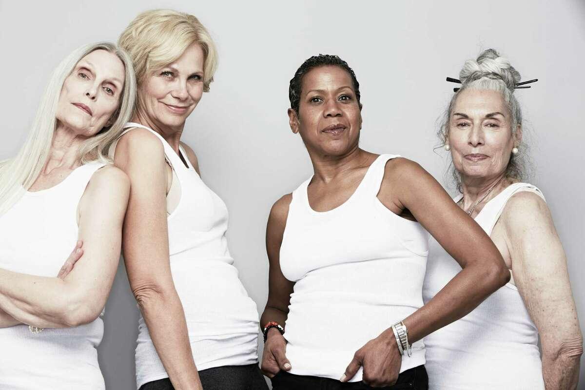 Studio portrait of senior women friends posing for camera