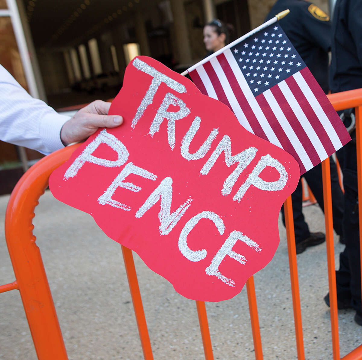 Protesters and supporters gather outside the Grand Hyatt Regency where Republican presidential nominee Donald Trump attends a fundraiser in San Antonio, Tuesday, Oct. 11, 2016.