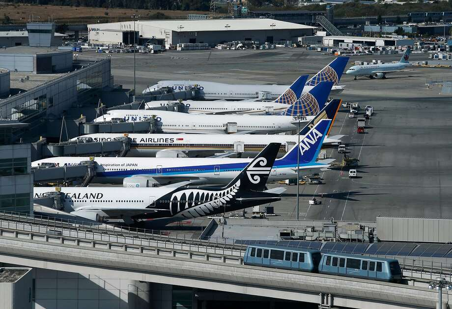 The entire airport can is visible from the new SFO air traffic control tower, including aircraft parked at the International Terminal in San Francisco. On Friday, scores of flights were delayed or canceled due to the bad weather. Photo: Paul Chinn, The Chronicle