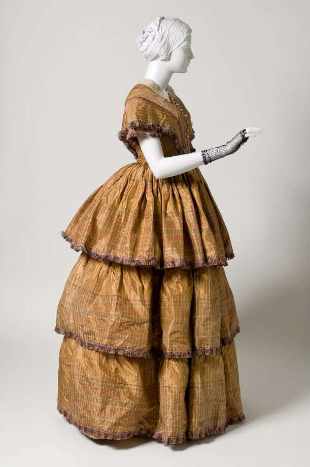 This afternoon dress, made in 1850, is among more than 20 elegant gowns that are on display at the Bruce Museum through June Sept. 5. It comes from the museum's collection, a 1960 gift from Mrs. E. Rayne Herzog. Photo: Contributed Photo / Stamford Advocate Contributed