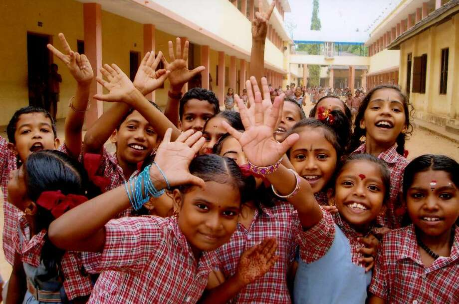 School children in Kumarakom are excited to see Westerners. Photo: Contributed Photo / Greenwich Citizen