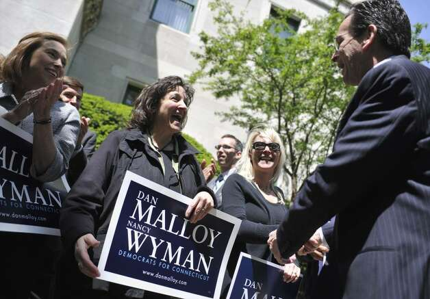 Supporters greet former Stamford Mayor and Democratic gubernatorial candidate Dan Malloy at the Capitol in Hartford, Conn., Tuesday, May 11, 2010.  Malloy announced that State Comptroller Nancy Wyman will be his running mate. (AP Photo/Jessica Hill) Photo: Jessica Hill, AP / AP2010