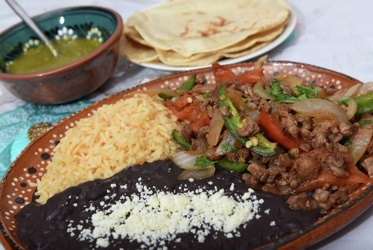 Bistec a la Mexicana at Oaxaquena Triqui at 77 N. Lake Ave. on Wednesday, Sept. 28, 2016 in Albany, N.Y. The dish includes meat sliced and sauteed with jalapeno peppers, onions, tomatoes and garlic. Served with rice and beans. (Lori Van Buren / Times Union)