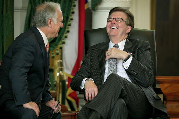 Sen. Kirk Watson, left, shares a lighter moment with Lt. Governor Dan Patrick, right, during a brief pause as they wait on amendments to be printed, Wednesday, May 27, 2015 in Austin, Texas. (Ralph Barrera/Austin American-Statesman via AP)  AUSTIN CHRONICLE OUT, COMMUNITY IMPACT OUT, INTERNET AND TV MUST CREDIT PHOTOGRAPHER AND STATESMAN.COM, MAGS OUT