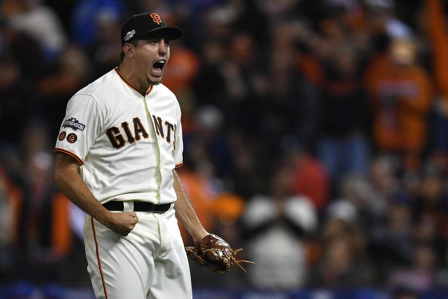 SAN FRANCISCO, CA - OCTOBER 10:  Derek Law #64 of the San Francisco Giants reacts after final out of the sixth inning of Game Three of their National League Division Series against the Chicago Cubs at AT&T Park on October 10, 2016 in San Francisco, California.  (Photo by Thearon W. Henderson/Getty Images) Photo: Thearon W. Henderson, Getty Images