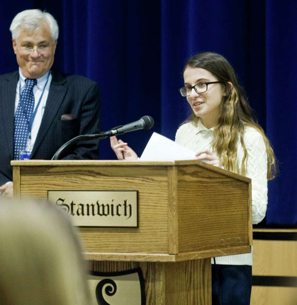 Democratic Town Committee Chair Jeff Ramer is introduced by senior Yona Davershi at an assembly in the Stanwich School gymnasium. Tuesday, Oct. 11, 2016