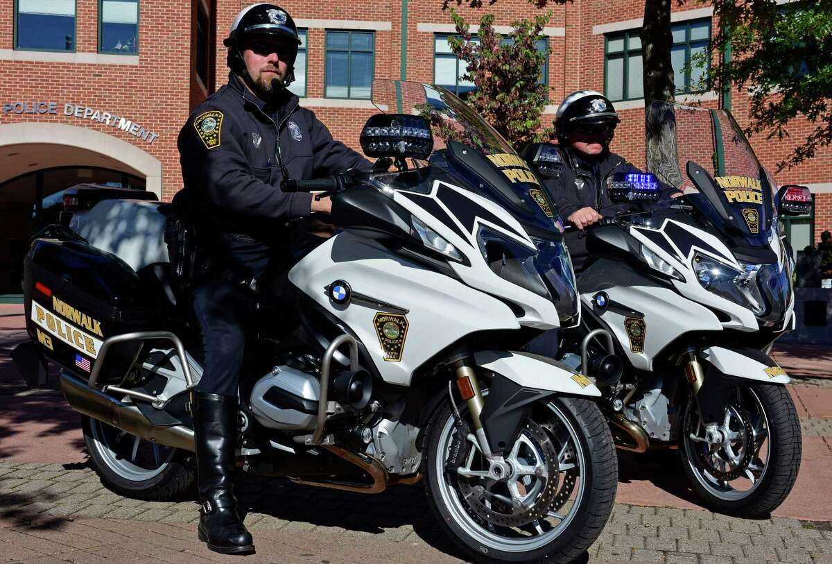 Norwalk Police Department Traffic Unit officers, Jon Zavitz and John Haggerty, display the unit's new BMW R1200RT motorcycles Tuesday, October 11, 2016, in front of the Department in Norwalk, Conn.