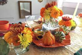 Classic fall tablescape: I found the dishware and glasses at the Dollar Tree store, so a placesetting for four cost $16 for a plate, bowl, goblet and glass. These may not be the heirlooms I bequeath in my will, but for a fun party, paying $1 per piece of colorful dish or glassware seems worth it. Grocery and big-box stores almost all have bags of these mini-pumpkins, and they're classic for good reason: They last at least a month and they're easy to move around your home for a pop of fall anywhere.