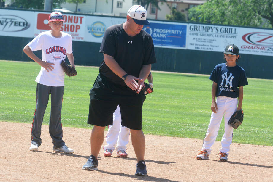 Plainview baseball coach Brandon Gilliland gives campers some pointers on infield play at the PISD Summer Baseball Camp of Champions last week. Gilliland has been named the head coach of the Bulldogs, replacing Jimmy Webster, who has accepted a job at Odessa Permian after four years at the helm of the Dogs. Photo: Skip Leon/Plainview Herald