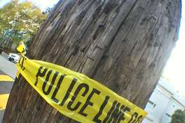 In this file photo, crime scene tape is wrapped around a pole on Russian Hill.
