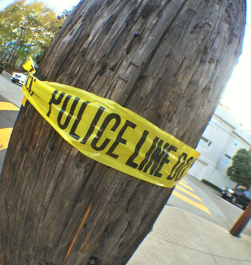 In this file photo, crime scene tape is wrapped around a pole on Russian Hill. Photo: Bill Hutchinson