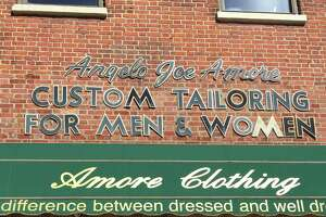 """Angelo """"Joe"""" Amore, 88, began his apprenticeship in Italy at age 8 and has operated a tailor's shop and custom suit store at the top of State Street in the shadow of the Capitol and City Hall for more than 50 years. """"My whole life is downtown,"""" said Amore, who refused to relocate to his son Robert's flashy new clothing store in Newton Plaza in Colonie. Amore reminisced about his friendship with Mario Cuomo, Erastus Corning 2nd and the ghosts of old Albany (Paul Grondahl / Times Union)"""