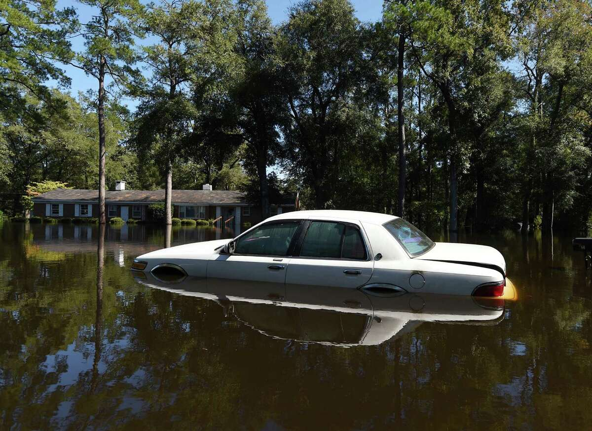 A car is surrounded by floodwaters on Highway 9, Tuesday, Oct. 11, 2016, in Nichols, S.C. About 150 people were rescued by boats from flooding in the riverside village of Nichols on Monday. (AP Photo/Rainier Ehrhardt)