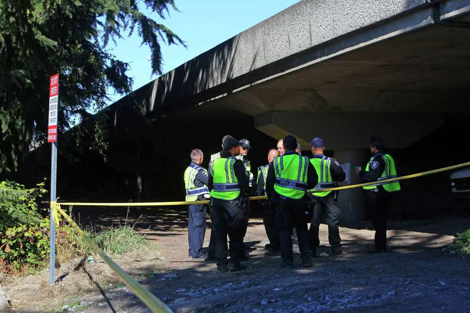 """Police are gathered at the scene of an officer-involved shooting on Oct. 11, 2016, at Airport Way South and South Bayview Street, near the """"Jungle"""" homeless encampment that was being cleared out to relocate its residents. Two people were reported with injuries, one critical, one minor. Photo: GENNA MARTIN, SEATTLEPI.COM / SEATTLEPI.COM"""