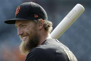 San Francisco Giants right fielder Hunter Pence warms up before Game 4 of baseball's National League Division Series against the Chicago Cubs in San Francisco, Tuesday, Oct. 11, 2016. (AP Photo/Ben Margot)