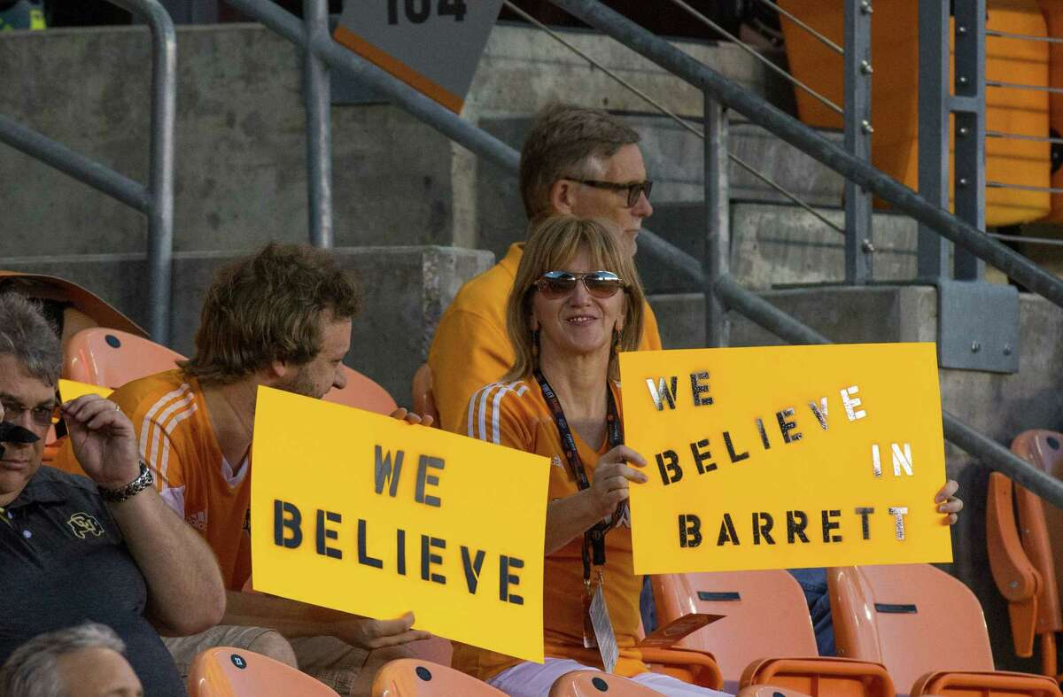 Dynamo fans display signs of support for interim coach Wade Barrett, left, prior to the match against New York City FC at BBVA Compass Stadium on Sept. 30.