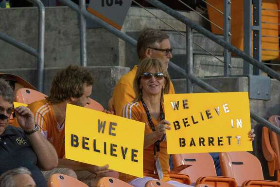 Dynamo fans display signs of support for interim coach Wade Barrett, left, prior to the match against New York City FC at BBVA Compass Stadium on Sept. 30. There has been no word whether the Dynamo front office shares the fans' sentiment.