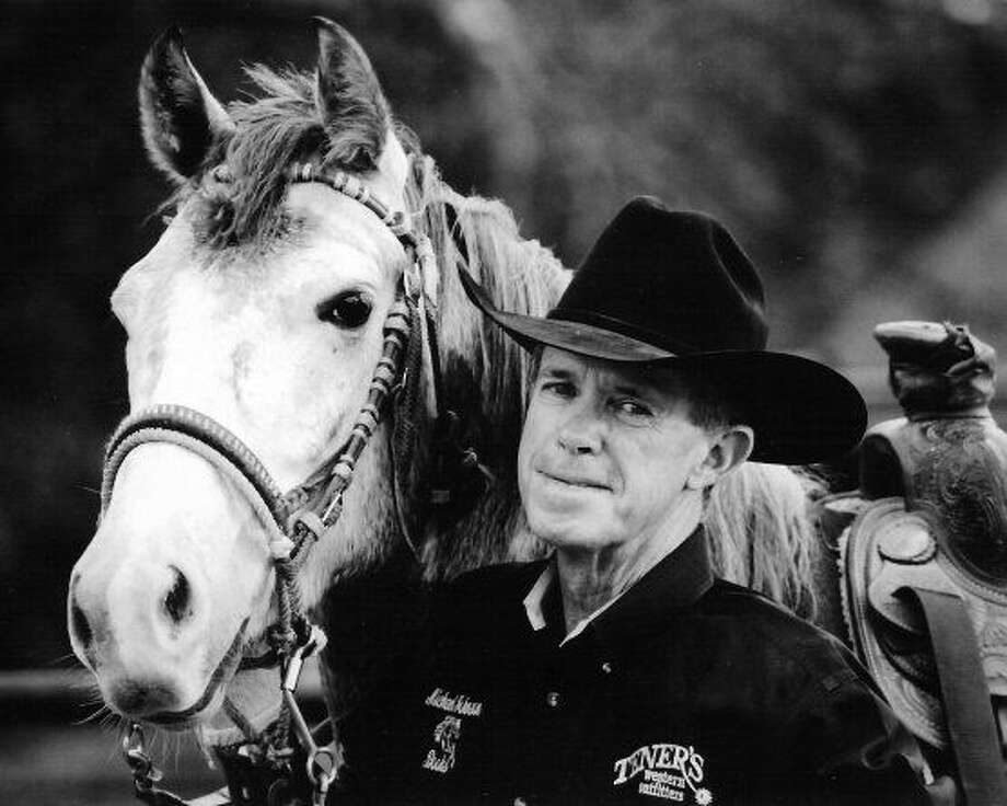 Courtesy Photo Michael Johnson, an award-winning author, humorist and playwright will keynote the Sept. 10 Plainview FFA Alumni Association scholarship dinner at the Plainview County Club. The Campbell, Texas, resident is shown with one of his roping horses, Blue.