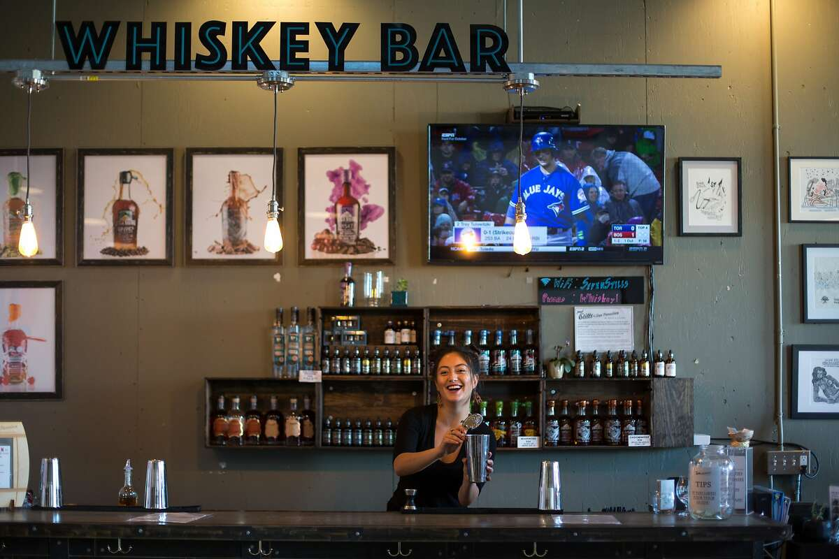 Samantha Hyland, the bartender, makes a drink at Seven Stills on Friday, Sept. 30, 2016 in San Francisco, Calif. Seven Stills is a brewery and whiskey distillery in the Bayview neighborhood.