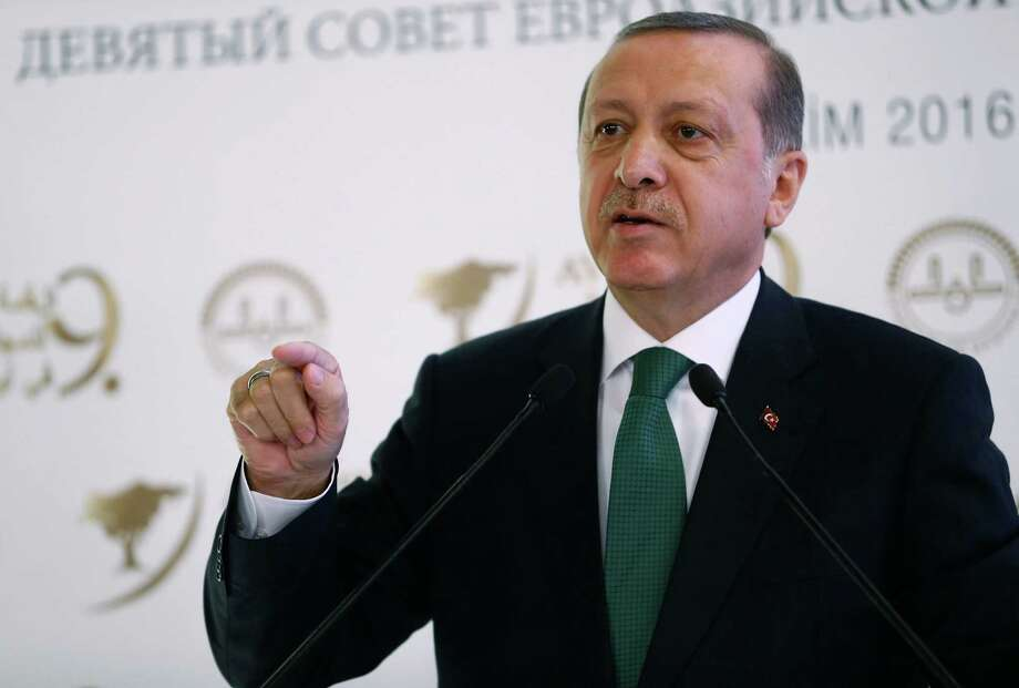 Turkish President Recep Tayyip Erdogan speaks during a meeting on Islam in Eurasia in Istanbul, Tuesday, Oct. 11, 2016. Erdogan says his country is determined to take part in a possible operation to recapture the Iraqi city of Mosul despite objections from Iraq, adding to tensions between the two neighbors. Erdogan on Tuesday also said Turkish troops would not withdraw from a base in northern Iraq near Mosul, where they are training anti-IS fighters Iraqi, saying the Turkish army would not take orders from Baghdad. (Kayhan Ozer, Presidential Press Service, Pool photo via AP) Photo: Kayhan Ozer, POOL / Pool Presidential Press Service