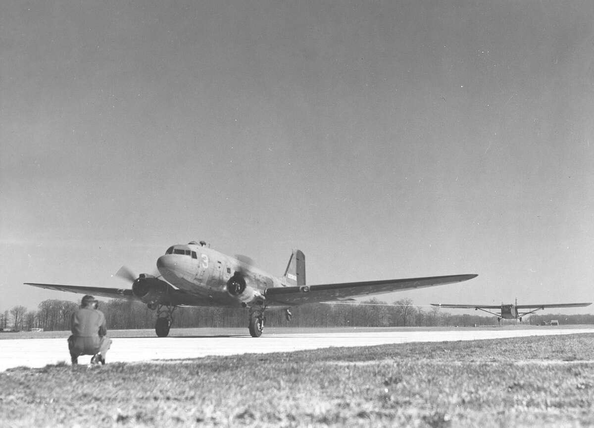 Courtesy Photo/Charles Day This photo, courtesy of Charles Day, national secretary of the National WWII Glider Pilot's Association, shows a Douglas C-47 Skytrain towing a WACO CG-4A glider into the air.