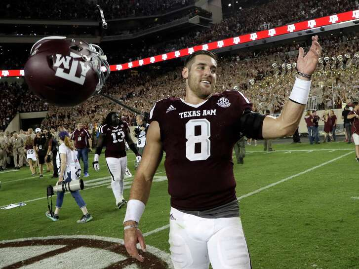 Texas A&M quarterback Trevor Knight, a former Reagan High School star, tosses his helmet as he celebrates after beating Tennessee on Oct. 8, 2016, in College Station. A&M won 45-38 in overtime.