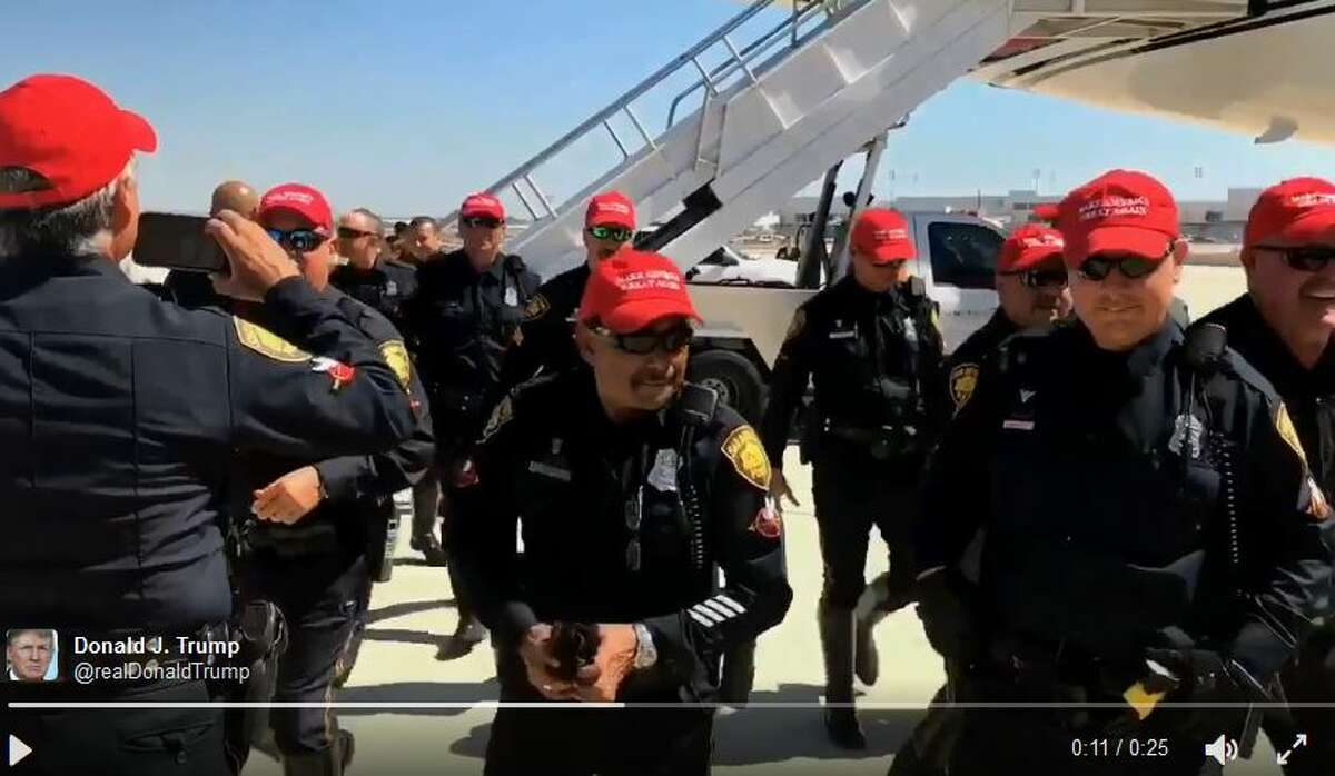 """Members of the San Antonio Police Department donned """"Make America Great Again"""" hats as Donald Trump left from the San Antonio Airport Oct. 11, 2016."""