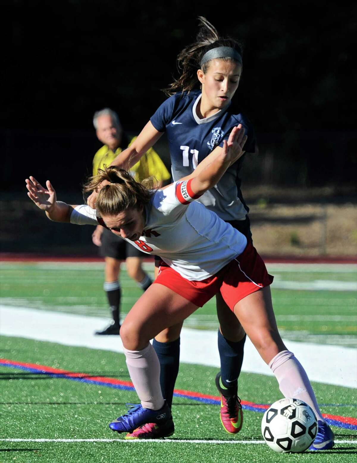 Immaculate's Kayla Mingachos (11) and Masuk's Nikki Bisesi (8) fight for the ball in the SWC girls soccer game between Immaculate and Masuk high schools, on Tuesday afternoon, October 11, 2016, at Masuk High School, in Monroe, Conn.