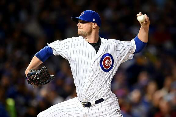 CHICAGO, ILLINOIS - OCTOBER 07:  Jon Lester #34 of the Chicago Cubs pitches in the first inning against the San Francisco Giants at Wrigley Field on October 7, 2016 in Chicago, Illinois.  (Photo by Stacy Revere/Getty Images)