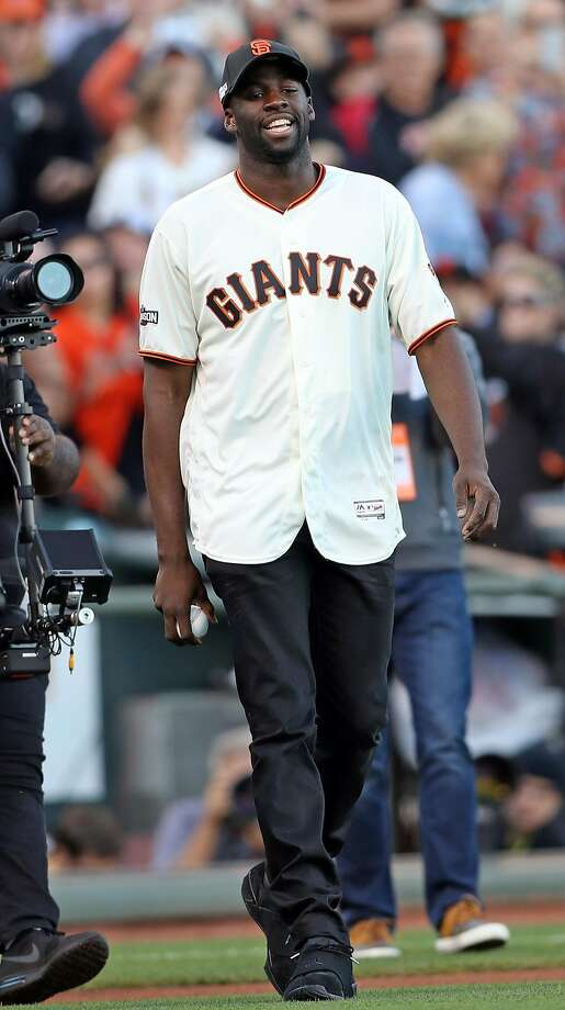 Golden State Warriors' Draymond Green throws out ceremonial first pitch before San Francisco Giants play Chicago Cubs in Game 4 of the National League Division Series at AT&T Park in San Francisco, Calif., on Tuesday, October 11, 2016. Photo: Scott Strazzante, The Chronicle