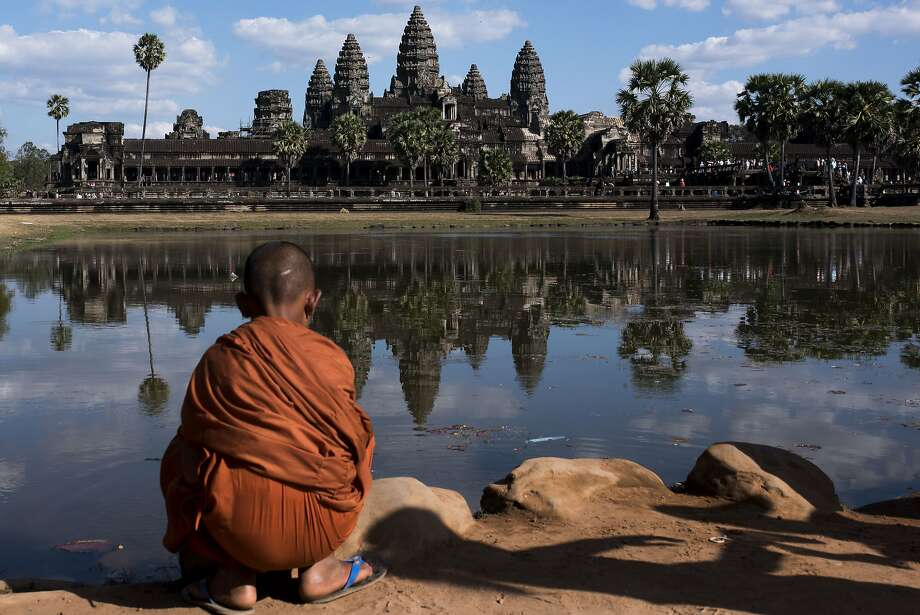 When visiting places such as Angkor Wat, travelers should respect local culture and customs. Photo: Xaume Olleros�/ Contributor, Getty Images