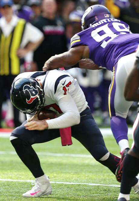 Brock Osweiler, left, has not played well for the Texans. But his job has been made more difficult by a leaky offensive line that allowed constant pressure Sunday by the Vikings, including Danielle Hunter on this play. Photo: Brett Coomer, Staff / © 2016 Houston Chronicle