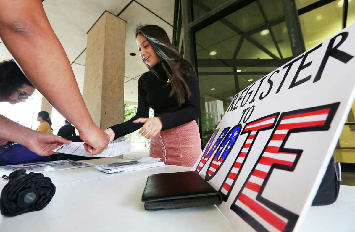 Emily Garcia Briones, a member of the University of Houston's Progressive Student Alliance, registers voters at the University of Houston on Tuesday, the last day to do so.