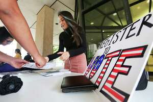 Emily Garcia Briones, a member of the Progressive Student Alliance, registers voters at the University of Houston on Tuesday, the last day to do so.