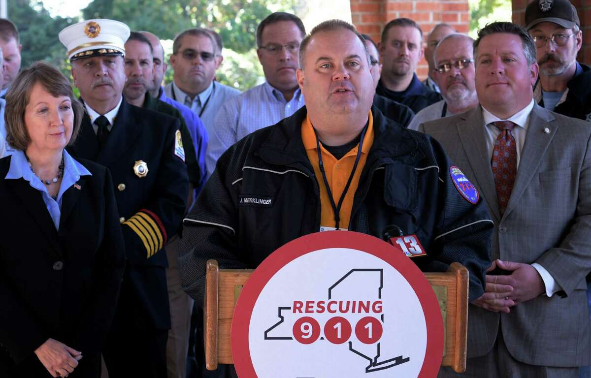John Merklinger, director of the City of Rochester 9-1-1 call center, was joined by other advocates for dedicated resources for 9-1-1 technology upgrades at a press conference held at the Albany Marriott in Colonie, N.Y. (Skip Dickstein/Times Union)