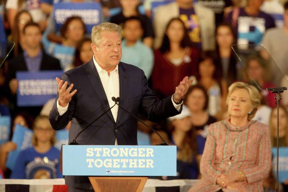 Former Vice President Al Gore speaks as Hillary Clinton listens in Miami at Miami Dade College. The two discussed climate change as well as the upcoming election. Photo: Mike Stocker, MBR / Sun Sentinel