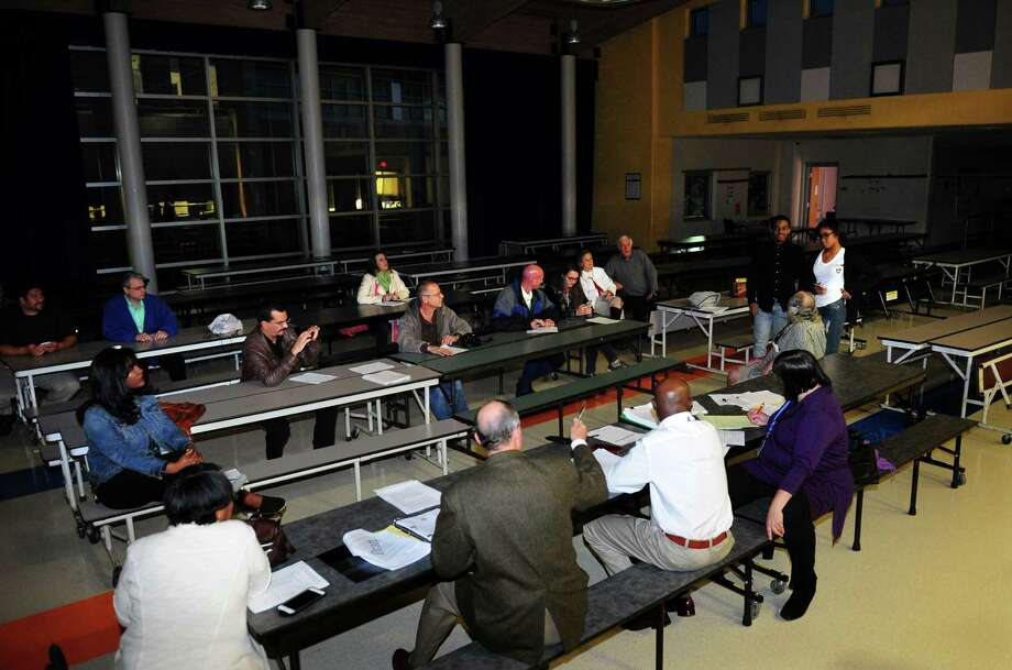 Several members of the Bridgeport Board of Education hold a meeting even after the cafeteria lights were turned out on them at Geraldine Johnson School in Bridgeport, Conn., on Tuesday Oct. 11, 2016. The BOE meeting scheuled for tonight was canceled last week by Dennis Bradley, the board chairman, but four members decided to have it anyway. Bradley is one of several members boycotting regularly scheduled meetings until fellow board member Maria Pereira resigns. Photo: Christian Abraham / Hearst Connecticut Media / Connecticut Post