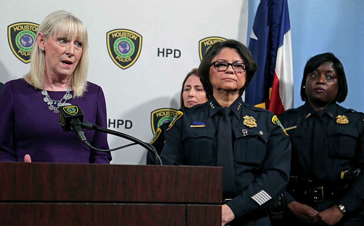 Houston Area Women's Center President Rebecca White, left, and HPD acting Chief Martha Mon-talvo, center, said the training will help police respond to domestic violence cases more effectively.