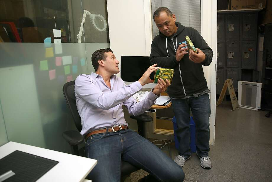 Co-founder Erich Pearson (left) discusses new packaging for his premium Marigold rolls with digital services manager Mar Fe de Leon (right) at the San Francisco Patient and Resource Center (SPARC) on Tuesday, October 11, 2016,  in San Francisco, Calif. Photo: Liz Hafalia, The Chronicle