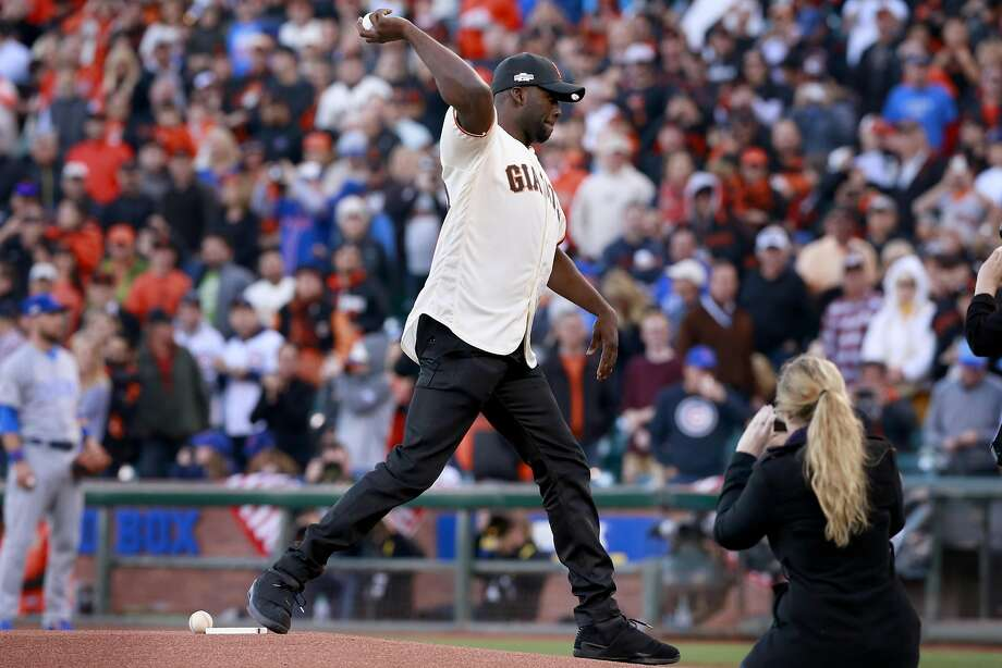 Golden State Warrior Draymond Green throws out the first pitch,  as the San Francisco Giants prepare to take on the Chicago Cubs in game 4 of the National League Division Series at AT&T Park on Tuesday October, 11  2016, in San Francisco, California. Photo: Michael Macor, The Chronicle