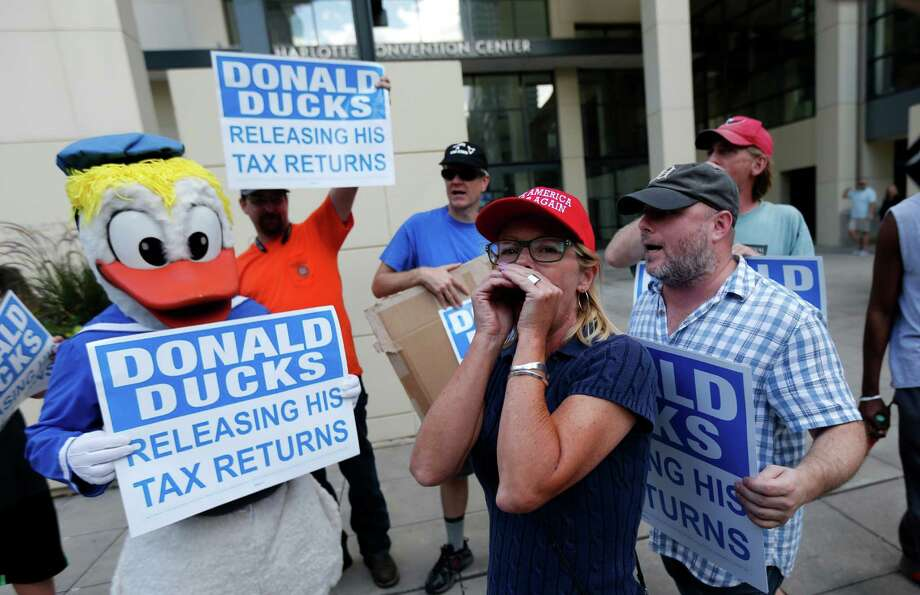"As controversy continues to rage over Donald Trump's failure to disclose his taxes, a new study says his revised tax plan aids mostly the wealthy. protesters chanting ""show us your taxes,"" outside the Charlotte Convention Center, where Trump was scheduled to give a campaign speech, in Charlotte, N.C. Thursday, Aug. 18, 2016. (AP Photo/Gerald Herbert) Photo: Gerald Herbert, STF / Copyright 2016 The Associated Press. All rights reserved. This material may not be published, broadcast, rewritten or redistribu"