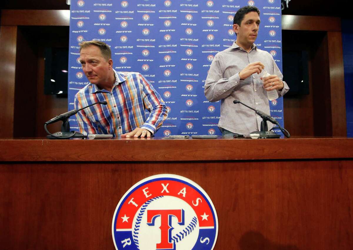 Texas Rangers manager Jeff Banister, left, and general manager Jon Daniels arrive to speak to reporters at the baseball park in Arlington, Texas, Tuesday, Oct. 11, 2016. What's next for \Daniels and the Texas Rangers? Instead of a long postseason run led by their aces, Texas was swept out of the ALDS. Suddenly there are questions after winning an AL-high 95 games.(AP Photo/LM Otero)