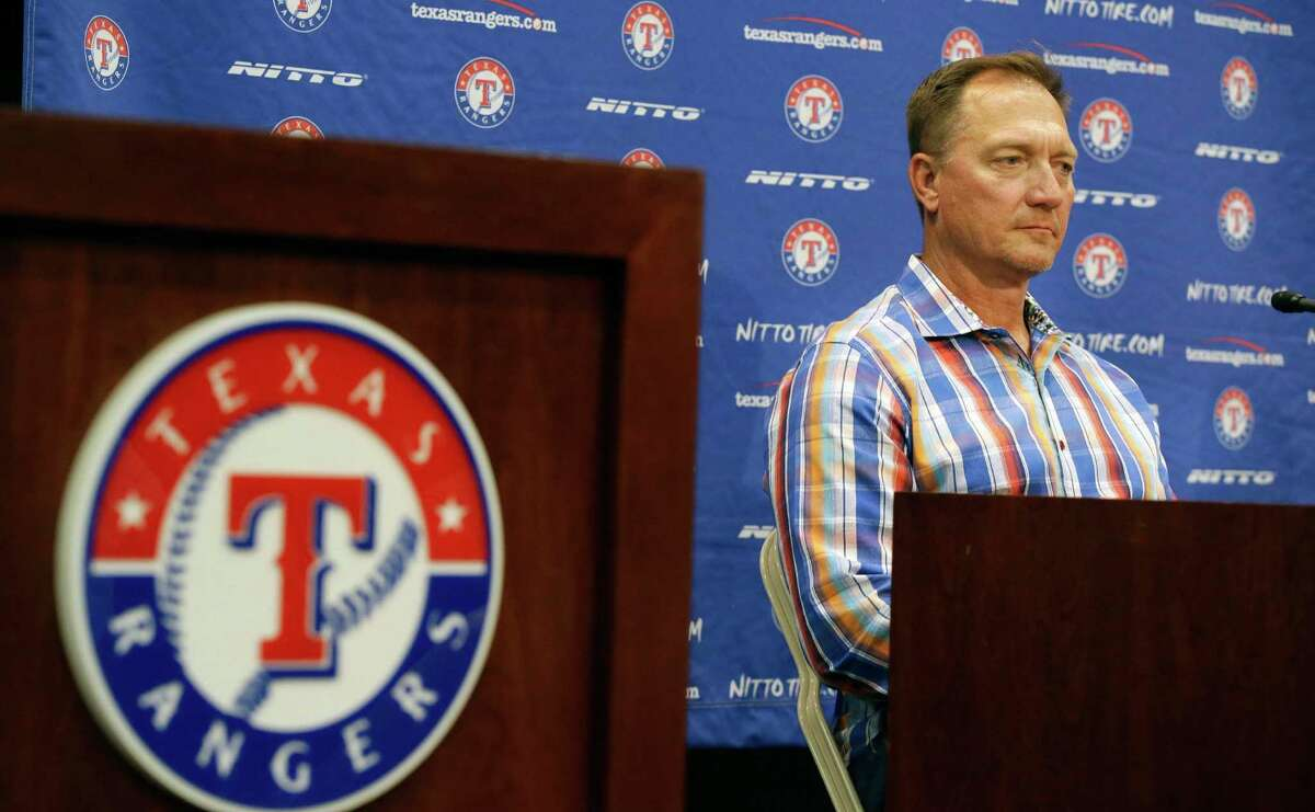 Texas Rangers manager Jeff Banister listens to a reporter's question at the baseball park in Arlington, Texas, Tuesday, Oct. 11, 2016. What's next for general manager Jon Daniels and the Texas Rangers? Instead of a long postseason run led by their aces, Texas was swept out of the ALDS. Suddenly there are questions after winning an AL-high 95 games. (AP Photo/LM Otero)
