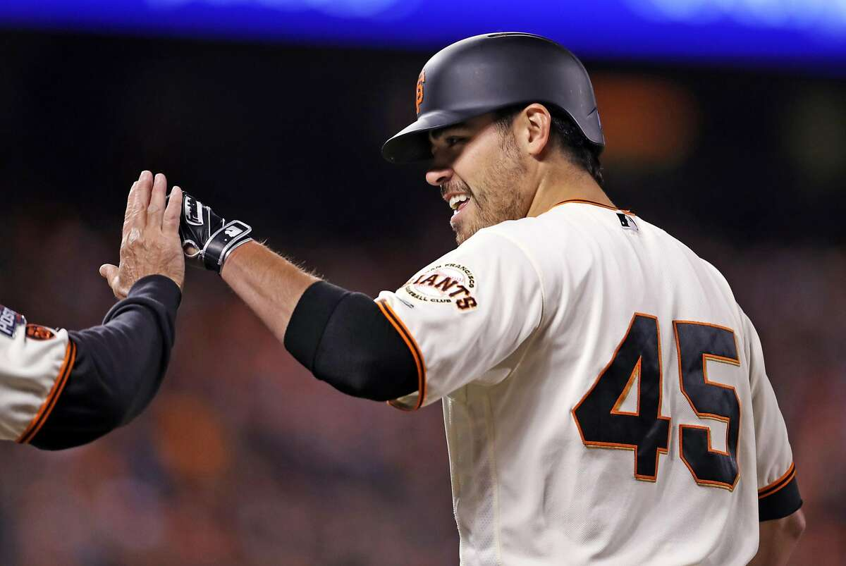 San Francisco Giants' starting pitcher Matt Moore celebrates his RBI single in 4th inning against Chicago Cubs during Game 4 of the National League Division Series at AT&T Park in San Francisco, Calif., on Tuesday, October 11, 2016.