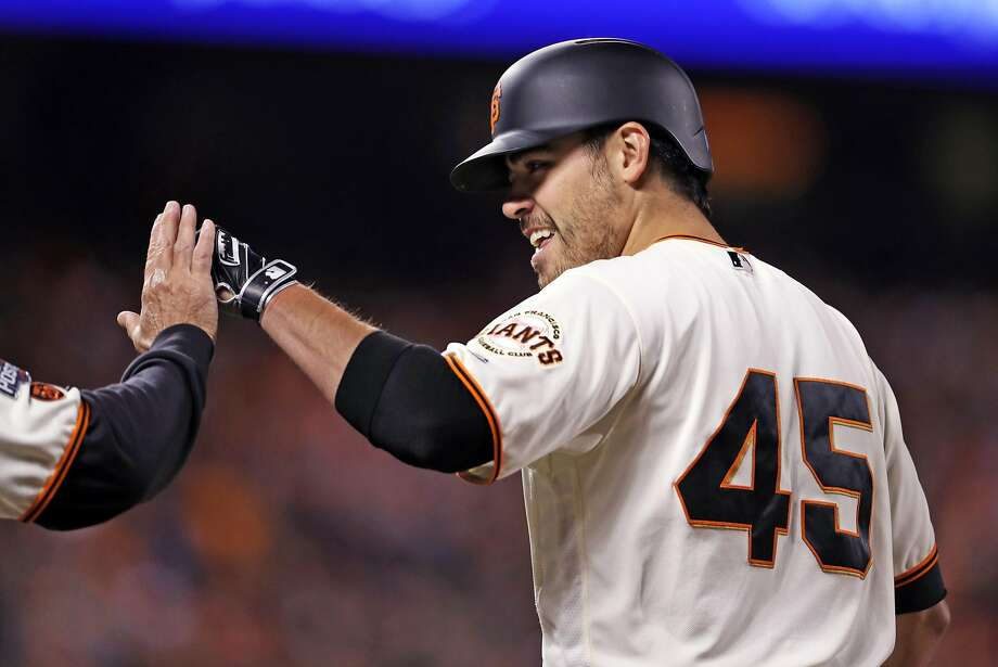San Francisco Giants' starting pitcher Matt Moore celebrates his RBI single in 4th inning against Chicago Cubs during Game 4 of the National League Division Series at AT&T Park in San Francisco, Calif., on Tuesday, October 11, 2016. Photo: Scott Strazzante, The Chronicle