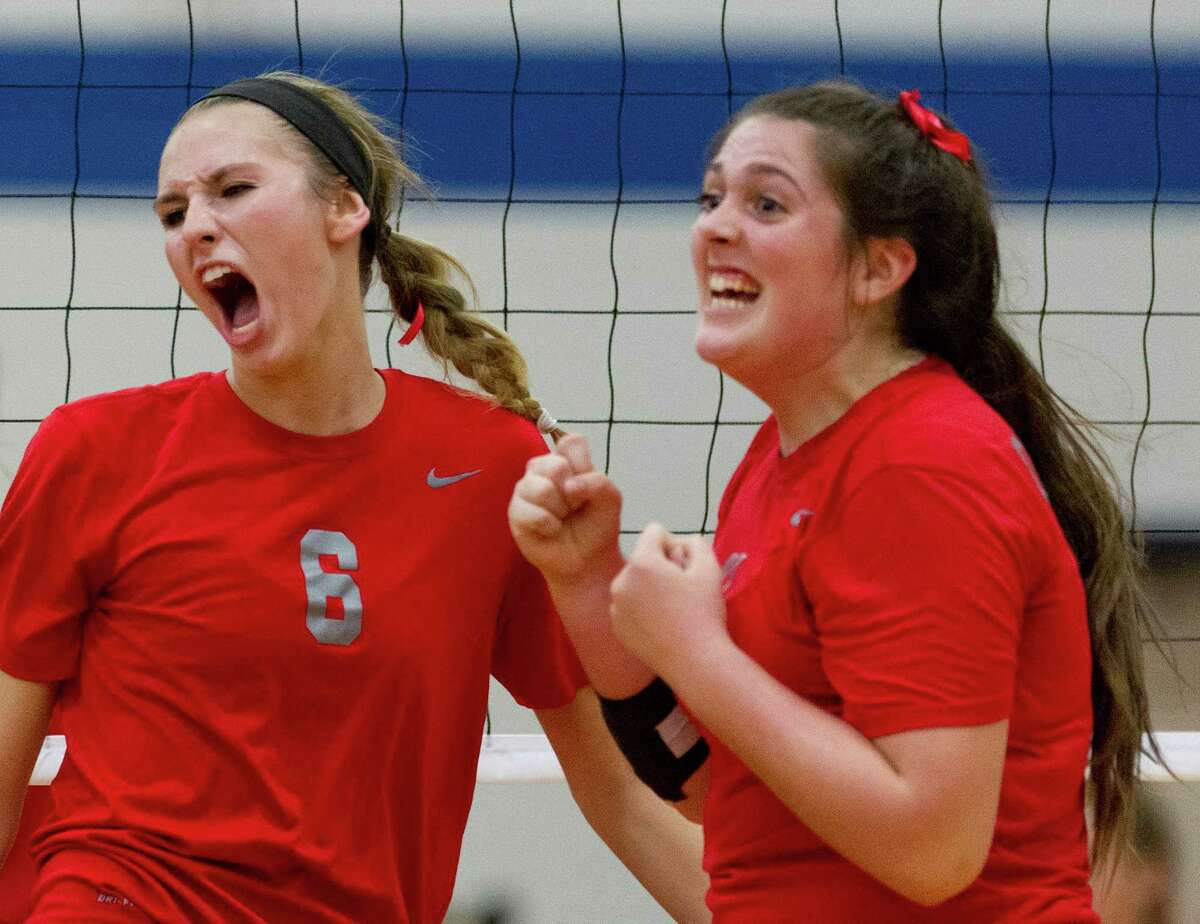 Oak Ridge's middle blocker Molly Russell (6) celebrates after a block with Carly Graham (11) during the second set of a District 12-6A volleyball match at Oak Ridge High School Tuesday in Oak Ridge.