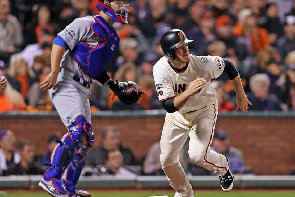 San Francisco Giants' Conor Gillaspie watches his 5th inning RBI single against Chicago Cubs during Game 4 of the National League Division Series at AT&T Park in San Francisco, Calif., on Tuesday, October 11, 2016.