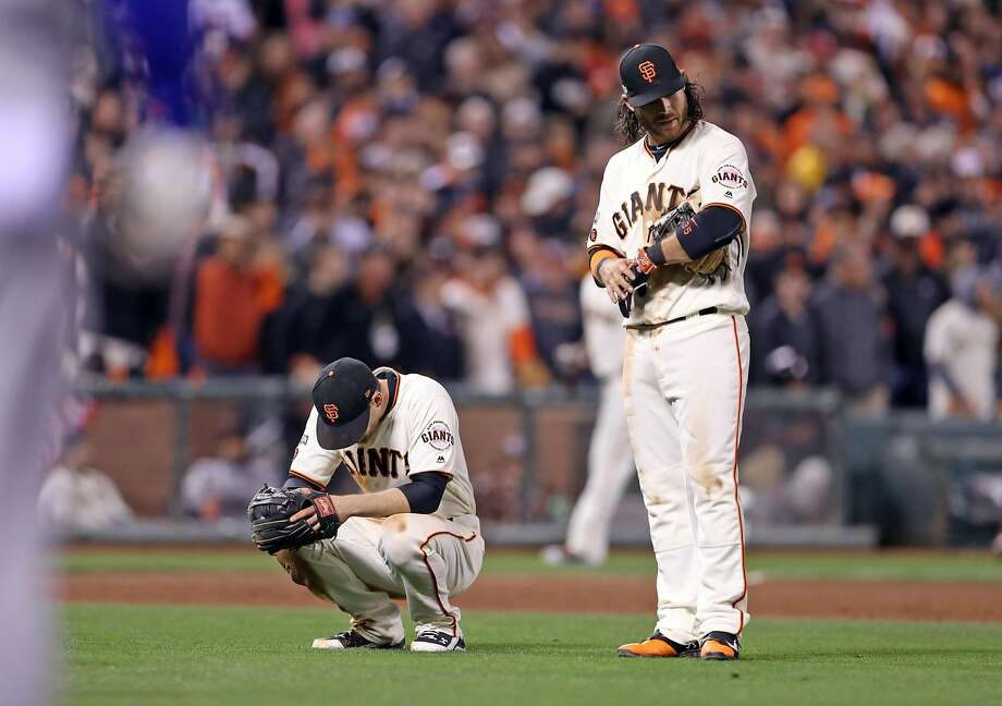 San Francisco Giants' Conor Gillaspie and Brandon Crawford react in Chicago Cubs' 4-run 9th inning during Game 4 of the National League Division Series at AT&T Park in San Francisco, Calif., on Tuesday, October 11, 2016. Photo: Scott Strazzante, The Chronicle