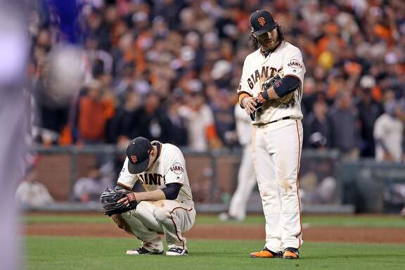San Francisco Giants' Conor Gillaspie and Brandon Crawford react in Chicago Cubs' 4-run 9th inning during Game 4 of the National League Division Series at AT&T Park in San Francisco, Calif., on Tuesday, October 11, 2016.