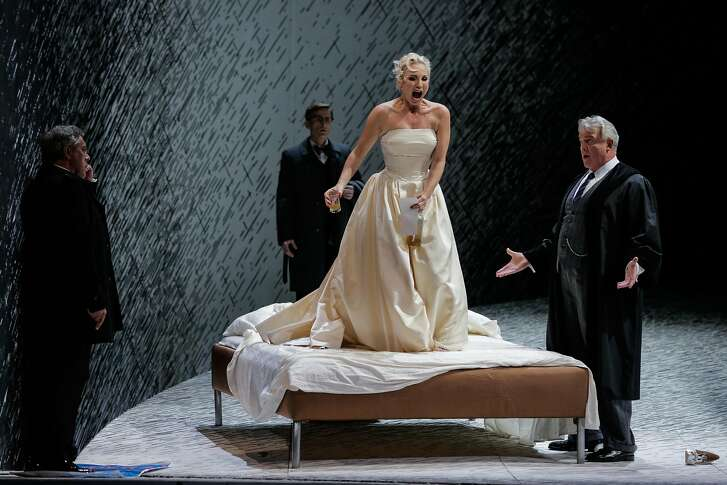 """Nadja Michael as Emilia Marty (center) in the performance, """"The Makropulos Case"""" at the San Francisco Opera, in San Francisco, California, on Tuesday, Oct. 11, 2016."""